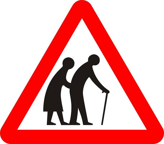 Frail or disabled pedestrians likely to cross road ahead road sign