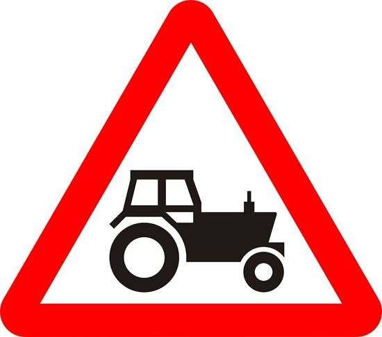 Agricultural vehicles likely to be in road ahead road sign